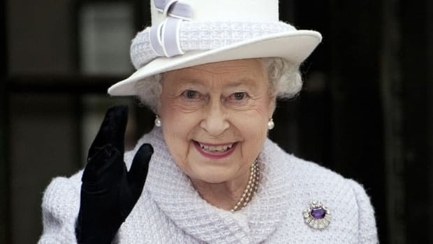 Britain's Queen Elizabeth waves during a visit to the Bank of England in the City of London on Dec. 13, 2012.