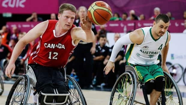 Canada's Patrick Anderson, left, dribbles the ball during the men's wheelchair basketball final game Saturday against Australia at the 2012 Paralympics.