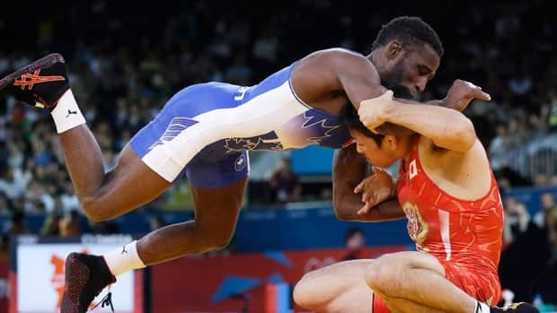 Haislan Veranes Garcia of Canada, left, grapples with his Japanese opponent at the 2012 Olympics.