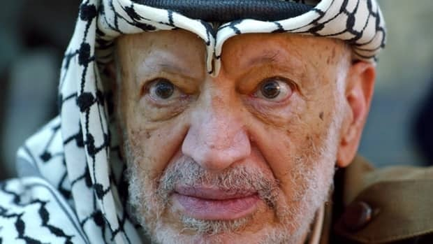 The remains of Palestinian leader Yasser Arafat, shown here in 2004, are to be exhumed by French, Swiss and Russian investigators.