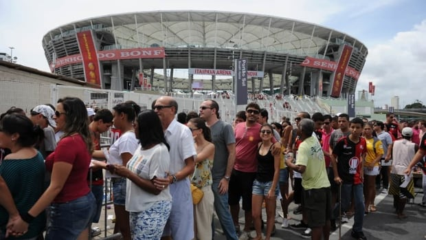Fans outside of Arena Fonte Nova stadium during its official inauguration in Salvador de Bahia, Brazil on April 7, 2013.