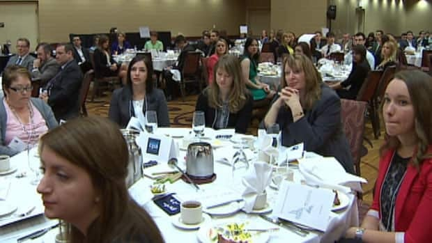 Business students from Memorial University listen intently at the 48th annual Business Day Conference in St. John's. CBC