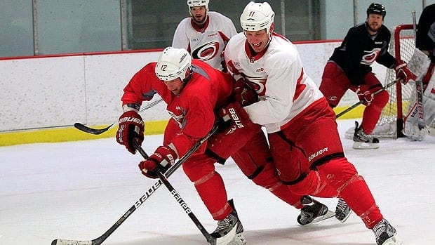 Jordan Staal, left, is now a member of the Carolina Hurricanes alongside older brother Eric, right.