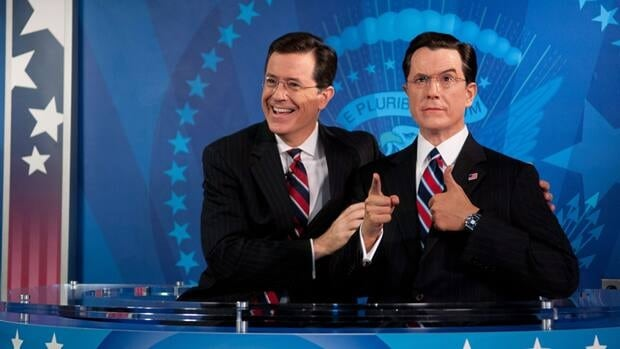 Stephen Colbert helps unveil his wax likeness Fiday in the Media Room at Madame Tussauds wax museum in Washington, which was renovated to include a replica set of The Colbert Report.