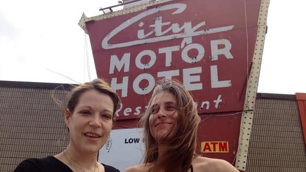 Amy Feltmate, left, and Elyse Exner say the City Motor Hotel is a good place to live, but Hamilton council has voted to expropriate and knock it down.
