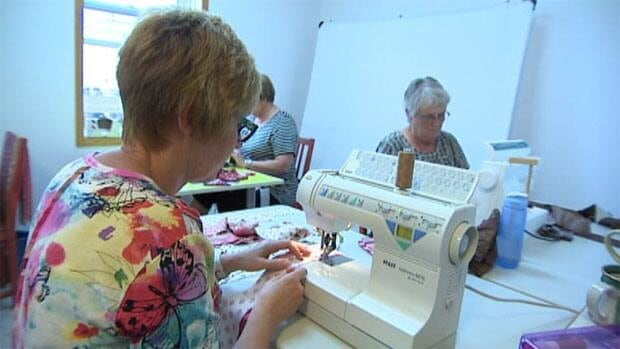 Moose Jaw quilters put their fingers to work sewing quilts for flood victims in Alberta.