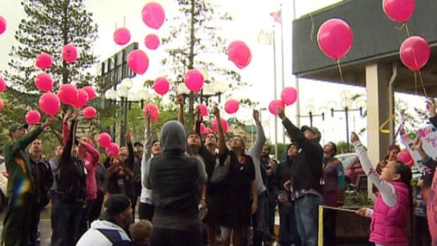 Supporters sang and released balloons in memory of two-year-old Geo Mounsef in Edmonton Saturday.