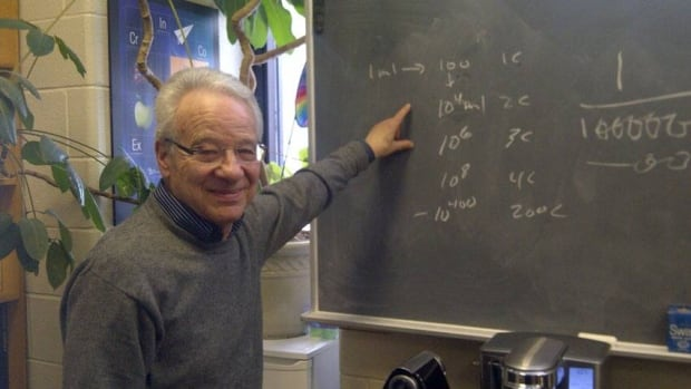 McGill University chemistry professor Ariel Fenster points to his calculation of just how diluted Oscillococcinum is.