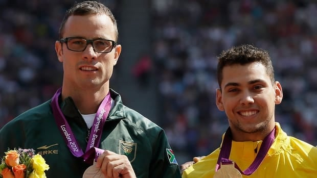 South Africa's Oscar Pistorius poses with the silver, left, and Brazil's Alan Fonteles Cardoso Oliveira with the gold at the medal ceremony for the men's 200-metre T44 at the London Paralympics on Sunday.