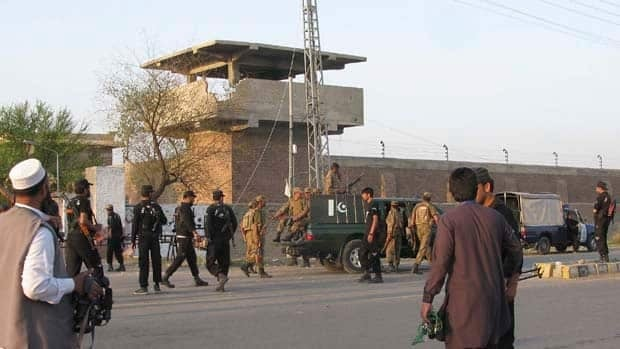 Pakistan army soldiers and other security officials surround a central jail in Bannu, 170 kilometres south of Peshawar, where Taliban militants freed close to 400 prisoners.