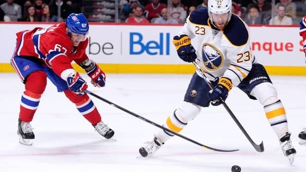 Ville Leino of the Buffalo Sabres stick handles the puck in front of Max Pacioretty of the Montreal Canadiens at the Bell Centre on Tuesday.