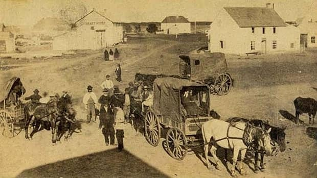 A photo shows an early traffic jam at the corner of Portage and Main in Winnipeg in June 1872.