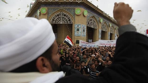 Iraqi Sunni Muslims take part in an anti-government demonstration Friday. At least three people were killed on Friday when Iraqi troops opened fire during clashes with Sunni protesters.