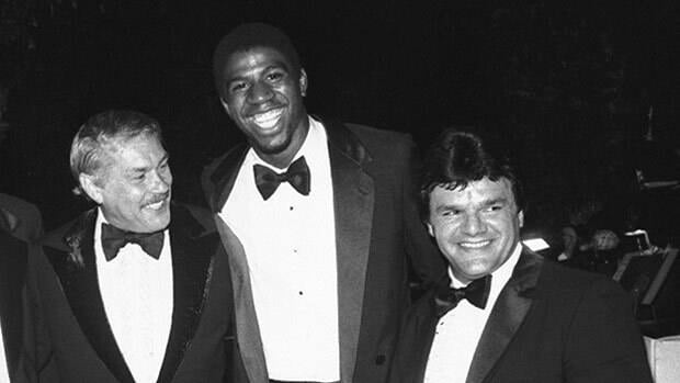 Los Angeles Kings owner Jerry Buss looks over in this 1980 picture at his high-priced star, Marcel Dionne. And, oh yeah, there's Magic Johnson of the Lakers.