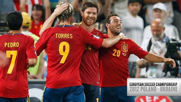 Spain's Xabi Alonso, centre, is congratulated by teammates after scoring his second goal against France on Saturday in Donetsk, Ukraine.