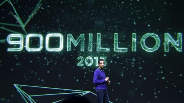Sundar Pichai, senior vice-president of Chrome and apps at Google, speaks about the 900 million Android devices that have been sold to date at the Google developers' conference in San Francisco on Wednesday. The same day, Google's stock surpassed $900 for the first time.