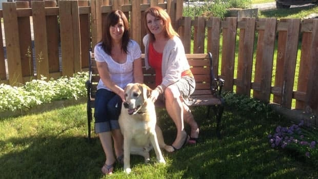 Lori Dingwall, right, her pet dog and her friend Nancy were chased and attacked by a deer last Thursday.