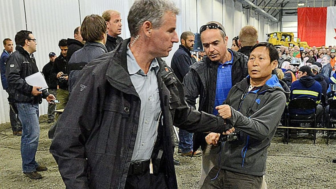 RCMP restrain Chinese reporter after tussle at Harper ...