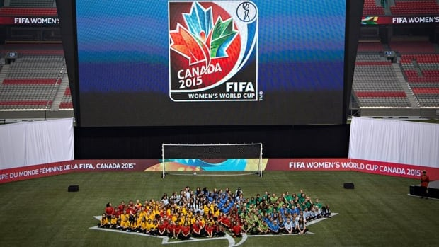 Young soccer players form the logo for the 2015 FIFA Women's World Cup during its unveiling in Vancouver on December 14, 2012. FIFA officials toured the Canadian host cities this week, saying some minor adjustments may still be needed, but most requirements have been met.