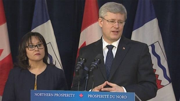 Prime Minister Stephen Harper taking questions from reporters after Monday's devolution announcement. Health Minister Leona Aglukkaq, who also heads up the Canadian Northern Economic Development Agency, joined him for the announcement in Yellowknife.