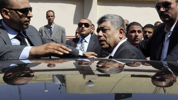 Interior Minister Mohamed Ibrahim, centre, has been among those responsible for Egypt's violent crackdown on supporters of Mohammed Morsi.