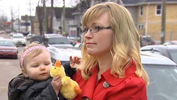 Parking problems now that she has a toddler have prompted Angela Court to give up shopping downtown.