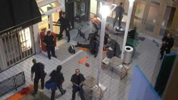 These images, taken from a student residence inside the mall, show the scene where three armoured-van guards were killed and another wounded.