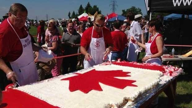 Red and white cake is served up at Saskatoon's Canada Day festivities at Diefenbaker Park on Monday.