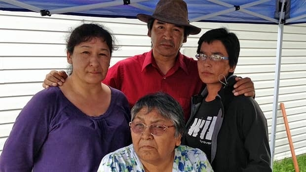 The family of Kevin Spade gathered at his Thunder Bay home on Monday to comfort each other after police found his body in Lake Superior — not far from where he had gone cliff jumping. Sitting in front is Kevin's grandmother Josie Kwandibens, and standing, left to right, are Kevin's mother Barbara Spade Dupuis, his uncle Peter Spade and his aunt Elaine Spade Kwandibens.