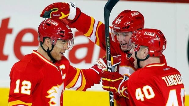 Calgary Flames' Jarome Iginla, left, and teammates Derek Smith, centre, and Alex Tanguay will be trying to win back fans next season.