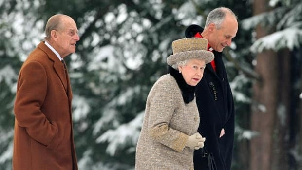 Queen Elizabeth II braved the cold and snow to attend church Sunday on the eve of her Diamond Jubilee anniversary.