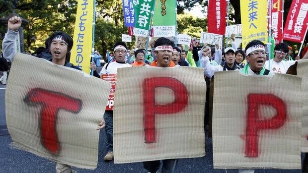 Farmers from tsunami-hit Miyagi Prefecture shout a slogan against a Trans-Pacific Partnership in 2011. Japan, like Canada, is debating whether to join the free trade zone that could be a game-changer for its member economies.