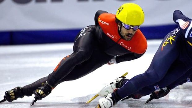 Charles Hamelin, left, of Sainte-Julie, Que., won gold at a World Cup event in Sochi, Russia on Saturday.