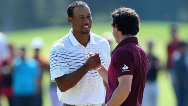 Tiger Woods, left, and Rory McIlroy shake hands following Thursday's match at Antalya Golf Club.