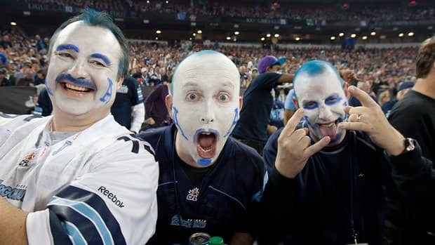 Toronto Argonauts fans celebrate during the 100th Grey Cup on Sunday at Rogers Centre.