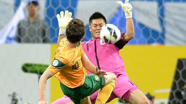 Japan's goalkeeper Eiji Kawashima stops a shot by Australia's Robbie Kruse during their World Cup qualifying match in Saitama, suburban Tokyo, on Tuesday.