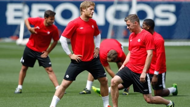 Canada players stretch as they prepare to practice on the pitch Saturday in Denver where they face Panama in a CONCACAF Gold Cup soccer match on Sunday.
