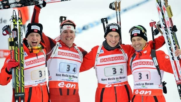 From left to right, Tarjei Boe, Emil Hegle Svendsen, Henrik L'Abee-Lund and Ole Einar Bjoerndalen celebrate after winning the men's 4x7.5-kilometre relay on Saturday.