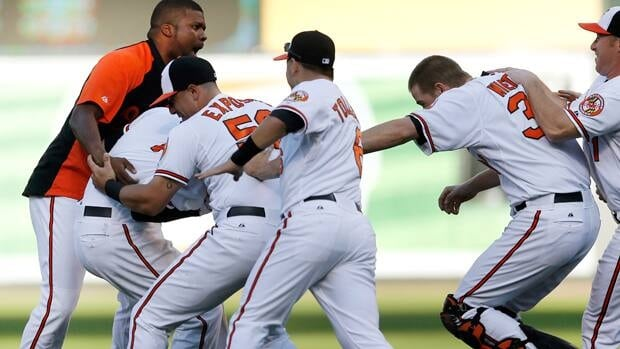 Members of the Baltimore Orioles celebrate with Manny Machado, second from left, after Adam Jones scored a run on Machado's single in the 14th inning at Camden.