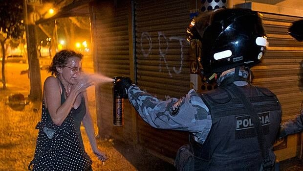 A military police pepper sprays a protester during a demonstration in Rio de Janeiro on Monday. Protesters massed in at least seven Brazilian cities Monday for another round of demonstrations voicing disgruntlement about life in the country, raising questions about security during big events like the current Confederations Cup.