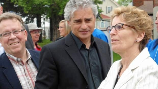 Municipal Affairs and Housing Minister Kathleen Wynne came to Thunder Bay to announce the region would receive provincial funding to help the area rebuild after an epic flood. She is pictured here with Thunder Bay area MPPs Michael Gravelle, left, and Bill Mauro, centre.