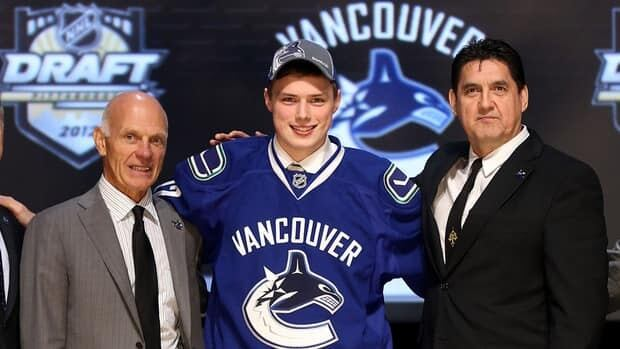 Brendan Gaunce, 26th overall pick by the Vancouver Canucks, poses with Canucks representatives on Friday.