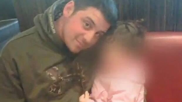 John Kwiatkowski, 29, pictured here with his young daughter, was killed in his east Edmonton home in April 2011.
