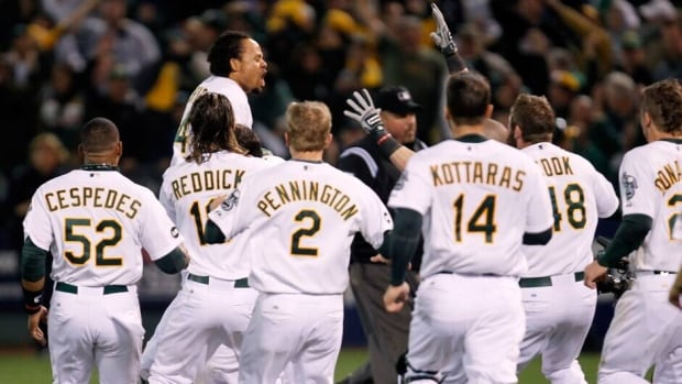 Oakland Athletics centre-fielder Coco Crisp, top, and his teammates are currently on top of the AL West division.