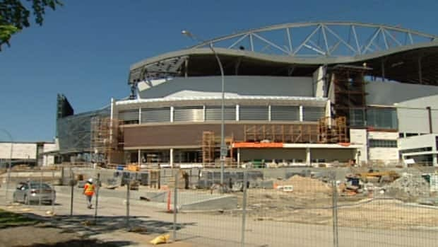 Construction of Investors Group Field has been hampered by delays.