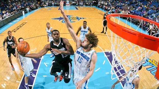 In this photo, Tyreke Evans, left, of the Sacramento Kings drives to the basket against New Orleans' Robin Lopez last season. Evans and Lopez are reportedly involved in a three-team trade along with Greivis Vasquez.