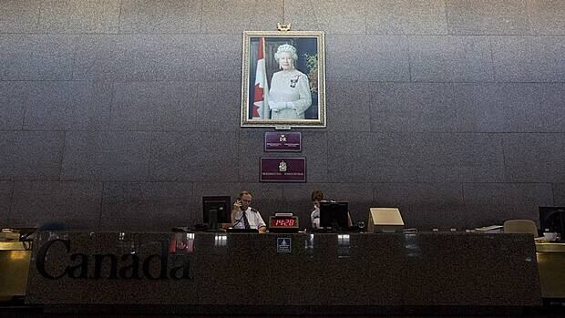 A portrait of the Queen hangs on the Sovereign's Wall at the entrance to the Department of Foreign Affairs building in Ottawa. Foreign Affairs' Office of Protocol keeps an eye on diplomats posted to Canada and their brushes with the law.