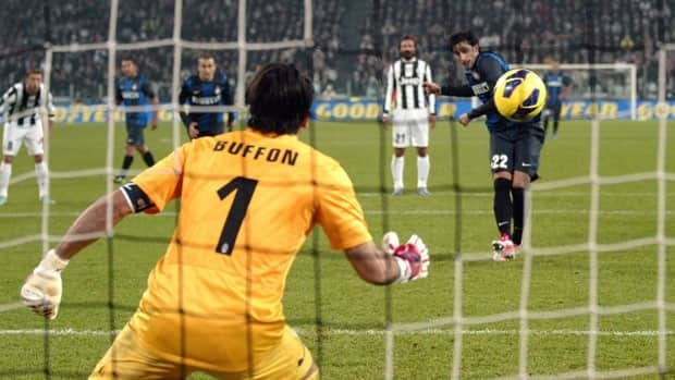 Inter Milan's Diego Milito scores past Juventus goalie Gianluigi Buffon on a penalty kick during the latest installment of the rivalry in Turin on Saturday. Felice Calabro/Associated Press