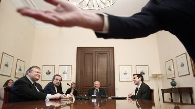 Greek President Karolos Papoulias (centre), socialist leader Evangelos Venizelos (first left) conservative leader Antonis Samaras (second left) and leftist leader Alexis Tsipras (right) , meet at the presidential palace in Athens, Sunday.