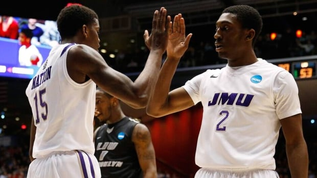 Ron Curry, right, and Andre Nation of the James Madison Dukes celebrate in the second half against the LIU Brooklyn Blackbirds during the first round of the 2013 NCAA Men's Basketball Tournament at University of Dayton Arena on Wednesday in Dayton, Ohio.